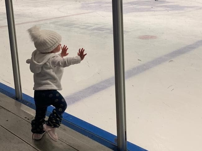 Baby Chloe at the rink on the floor.jpg