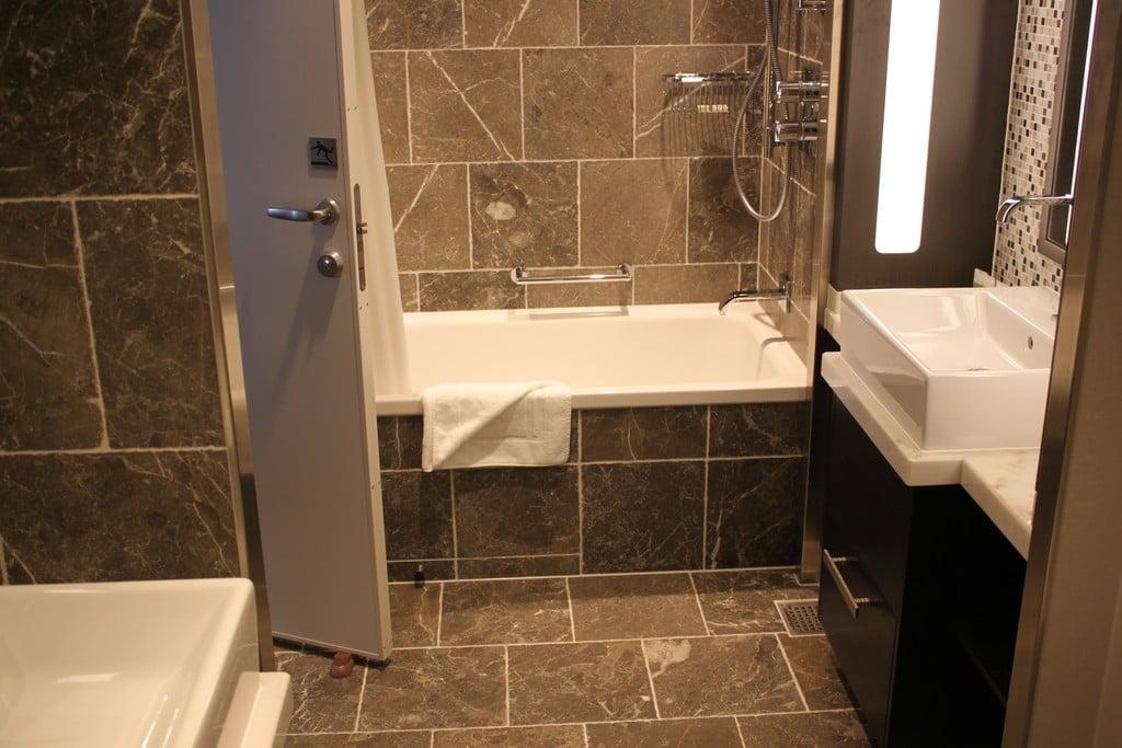 Caribbean bathroom decor photo tour of grand suite with for Caribbean bathroom design ideas